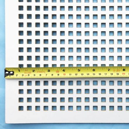 Square white faced perforated MDF screening panel